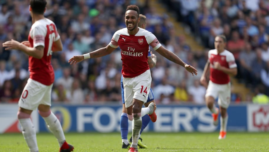 CARDIFF, WALES - SEPTEMBER 02: Pierre-Emerick Aubameyang of Arsenal celebrates after scoring a goal to make it 1-2 during the Premier League match between Cardiff City and Arsenal FC at Cardiff City Stadium on September 2, 2018 in Cardiff, United Kingdom. (Photo by James Baylis - AMA/Getty Images)
