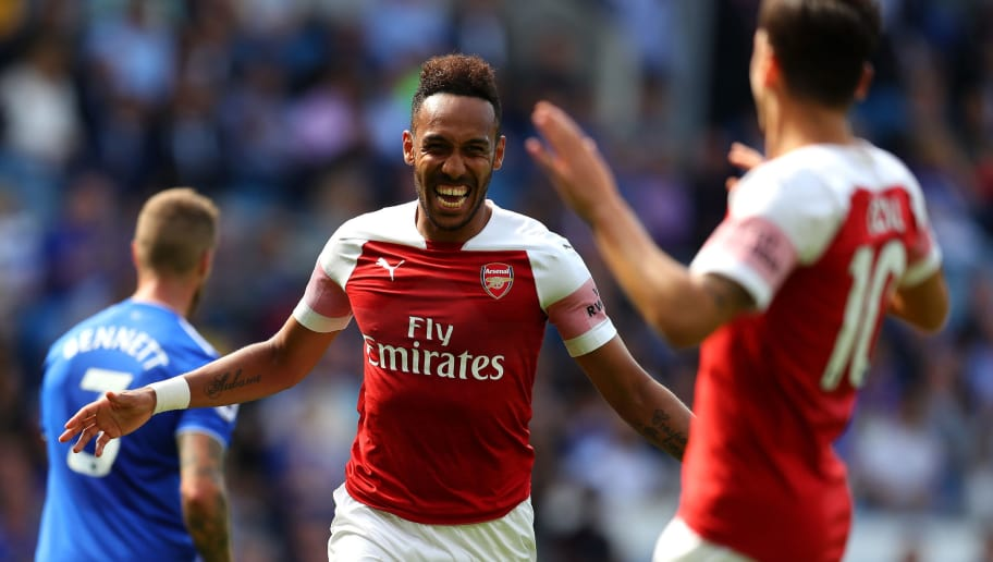 CARDIFF, WALES - SEPTEMBER 02:  Pierre-Emerick Aubameyang of Arsenal celebrates after scoring his team's second goal with Mesut Ozil during the Premier League match between Cardiff City and Arsenal FC at Cardiff City Stadium on September 2, 2018 in Cardiff, United Kingdom.  (Photo by Catherine Ivill/Getty Images)