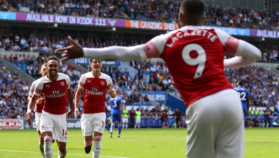 CARDIFF, WALES - SEPTEMBER 02: Pierre-Emerick Aubameyang of Arsenal celebrates after scoring his teams second goal by running to Alexandre Lacazette of Arsenal during the Premier League match between Cardiff City and Arsenal FC at Cardiff City Stadium on September 2, 2018 in Cardiff, United Kingdom. (Photo by Catherine Ivill/Getty Images)