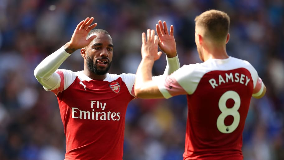 CARDIFF, WALES - SEPTEMBER 02:  Alexandre Lacazette and Aaron Ramsey of Arsenal celebrate victory after the Premier League match between Cardiff City and Arsenal FC at Cardiff City Stadium on September 2, 2018 in Cardiff, United Kingdom.  (Photo by Catherine Ivill/Getty Images)