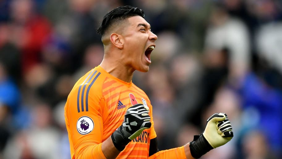 CARDIFF, WALES - NOVEMBER 10:  Neil Etheridge of Cardiff City celebrates after teammate Sol Bamba scores their team's second goal during the Premier League match between Cardiff City and Brighton & Hove Albion at the Cardiff City Stadium on November 10, 2018 in Cardiff, United Kingdom.  (Photo by Dan Mullan/Getty Images)