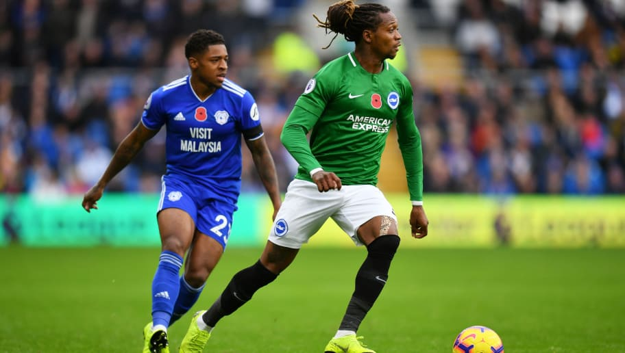CARDIFF, WALES - NOVEMBER 10:  Gaetan Bong of Brighton and Hove Albion runs with the ball under pressure from Kadeem Harris of Cardiff City  during the Premier League match between Cardiff City and Brighton & Hove Albion at the Cardiff City Stadium on November 10, 2018 in Cardiff, United Kingdom.  (Photo by Dan Mullan/Getty Images)
