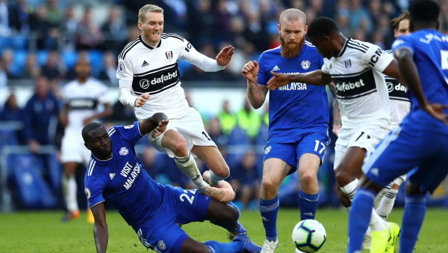 CARDIFF, WALES - OCTOBER 20: Andre Schurrle of Fulham is challenged by Sol Bamba of Cardiff City during the Premier League match between Cardiff City and Fulham FC at Cardiff City Stadium on October 20, 2018 in Cardiff, United Kingdom.  (Photo by Michael Steele/Getty Images)