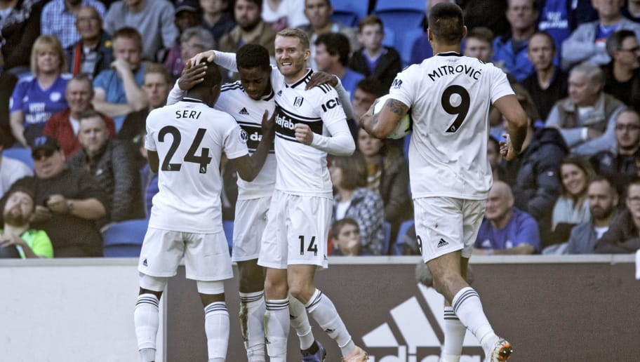 CARDIFF, WALES - OCTOBER 20: Ryan Sessegnon of Fulham (2nd L) celebrates his goal with co-scorer Andre Schurrle and team mates Jean Michael Seri (L) and Aleksandar Mitrovic during the Premier League match between Cardiff City and Fulham FC at the Cardiff City Stadium on October 20, 2018 in Cardiff, Wales. (Photo by Athena Pictures/Getty Images)