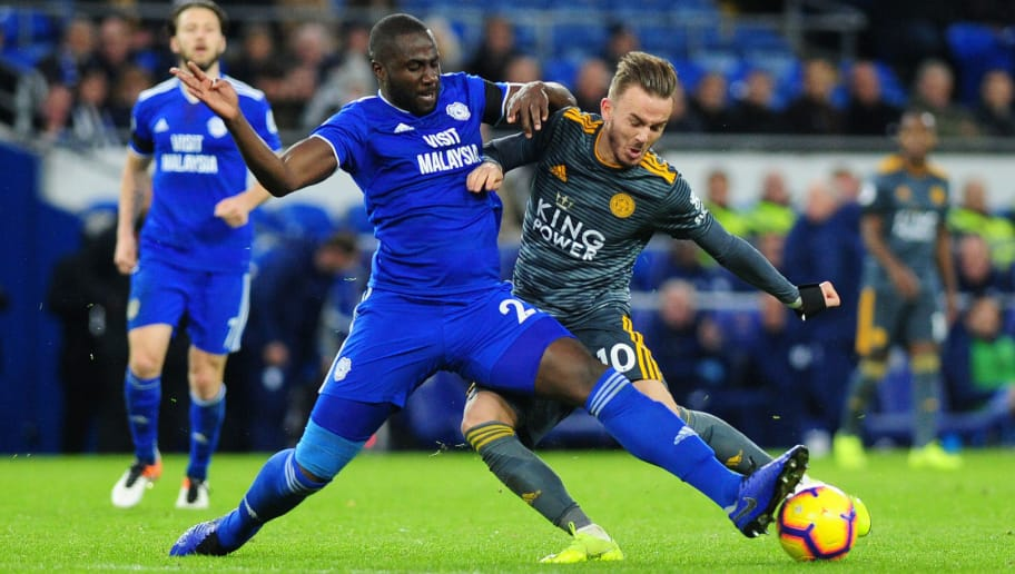 CARDIFF, WALES - NOVEMBER 3: James Maddison of Leicester City is tackled by Souleymane Bamba of Cardiff City during the Premier League match between Cardiff City and Leicester City at Cardiff City Stadium on November 3, 2018 in Cardiff, Wales. (Photo by Athena Pictures/Getty Images)