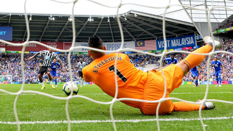 CARDIFF, WALES - AUGUST 18: Neil Etheridge of Cardiff City dives to save a penalty from Kenedy of Newcastle United during the Premier League match between Cardiff City and Newcastle United at Cardiff City Stadium on August 18, 2018 in Cardiff, United Kingdom.  (Photo by Dan Mullan/Getty Images)