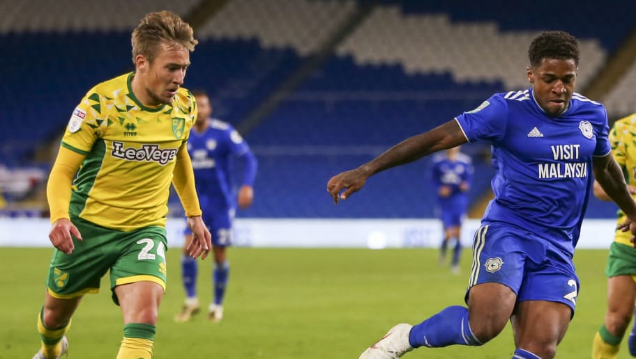 CARDIFF, WALES - AUGUST 28: Kadeem Harris of Cardiff City is closed down by Felix Passlack of Norwich City during the Carabao Cup Second Round match between Cardiff City and Norwich City at Cardiff City Stadium on August 28, 2018 in Cardiff, Wales. (Photo by Cardiff City FC/Getty Images)