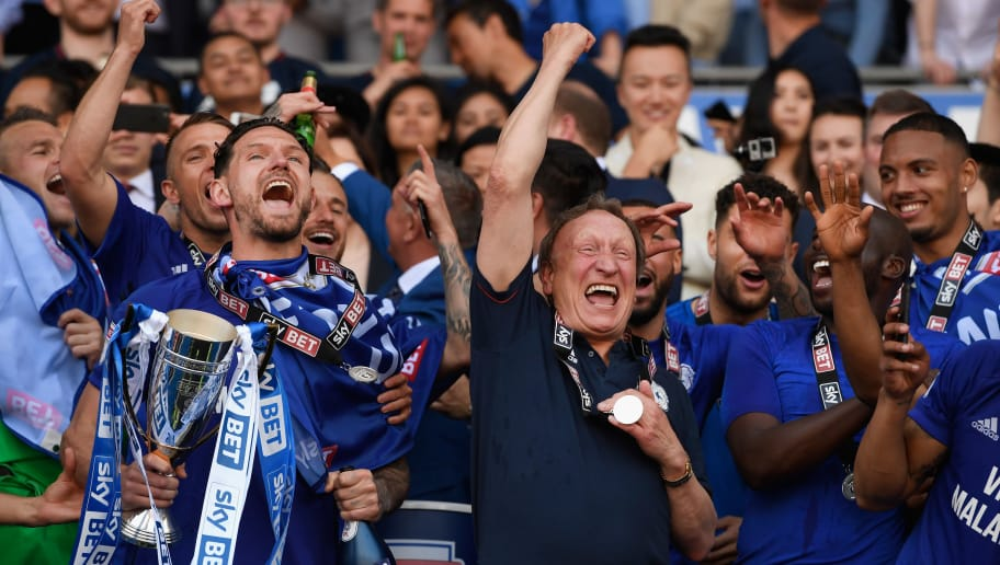 CARDIFF, WALES - MAY 06:  Cardiff captain Sean Morrison (l) and manager Neil Warnock celebrate promotion to the premier league after the Sky Bet Championship match between Cardiff City and Reading at Cardiff City Stadium on May 6, 2018 in Cardiff, Wales.  (Photo by Stu Forster/Getty Images)