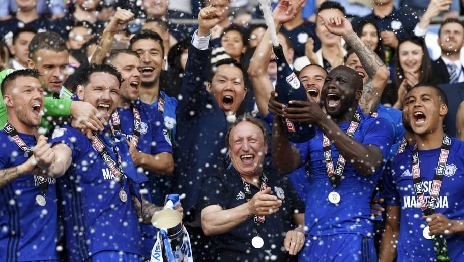 CARDIFF, WALES - MAY 06:  Neil Warnock, Manager of Cardiff City and his team celebrate with his team as they gain promotion to the premier league during the Sky Bet Championship match between Cardiff City and Reading at Cardiff City Stadium on May 6, 2018 in Cardiff, Wales.  (Photo by Stu Forster/Getty Images)