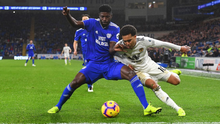 CARDIFF, WALES - NOVEMBER 30: Sol Bamba of Cardiff City and Helder Costa of Wolverhampton Wanderers during the Premier League match between Cardiff City and Wolverhampton Wanderers at Cardiff City Stadium on November 30, 2018 in Cardiff, United Kingdom. (Photo by Sam Bagnall - AMA/Getty Images)