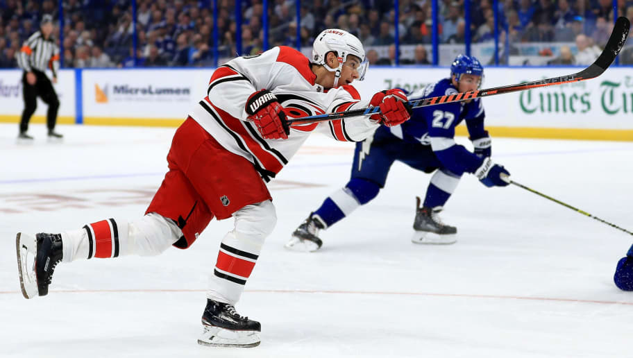 TAMPA, FL - OCTOBER 16:  Sebastian Aho #20 of the Carolina Hurricanes shoots during a game against the Tampa Bay Lightning at Amalie Arena on October 16, 2018 in Tampa, Florida.  (Photo by Mike Ehrmann/Getty Images)