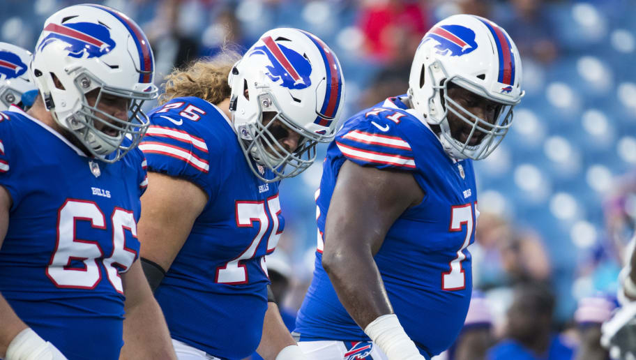 ORCHARD PARK, NY - AUGUST 09:  Russell Bodine #66, Wyatt Teller #75 and Marshall Newhouse #71 of the Buffalo Bills line up during warm ups for the game against the Carolina Panthers at New Era Field on August 9, 2018 in Orchard Park, New York. Carolina defeats Buffalo in the preseason game 28-23.  (Photo by Brett Carlsen/Getty Images)
