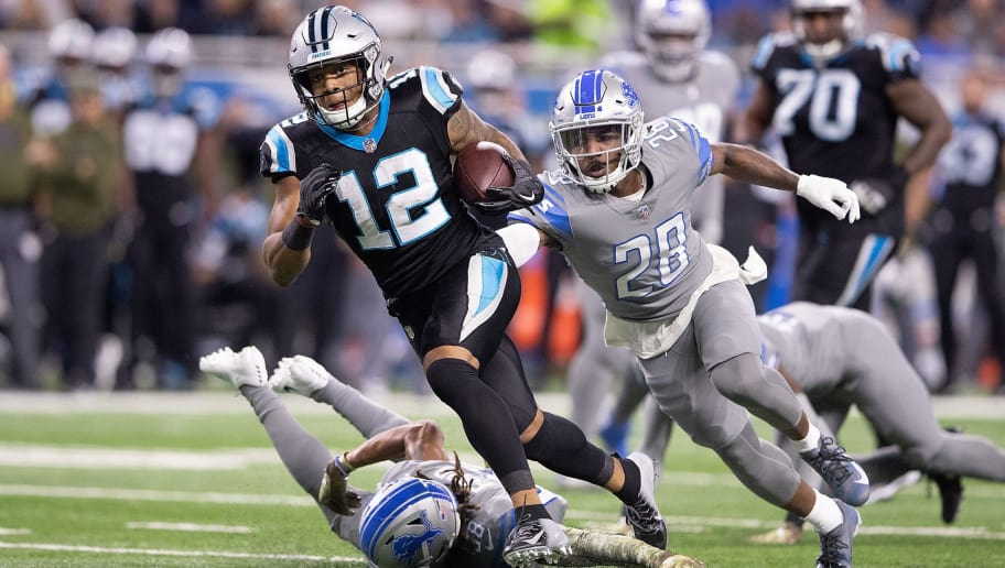 DETROIT, MI - NOVEMBER 18: DJ Moore #12 of the Carolina Panthers runs for a short gain as Quandre Diggs #28 of the Detroit Lions gives chase during the first quarter of the game at Ford Field on November 18, 2018 in Detroit, Michigan (Photo by Leon Halip/Getty Images)