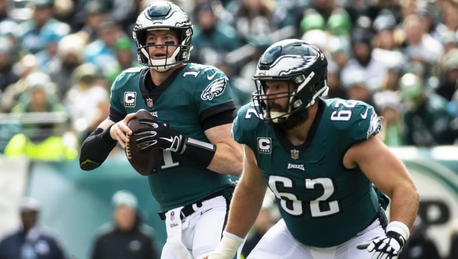 PHILADELPHIA, PA - OCTOBER 21:  Carson Wentz #11 of the Philadelphia Eagles drops back to pass behind Jason Kelce #62 during the first quarter against the Carolina Panthers at Lincoln Financial Field on October 21, 2018 in Philadelphia, Pennsylvania. Carolina defeats Philadelphia 21-17.  (Photo by Brett Carlsen/Getty Images)