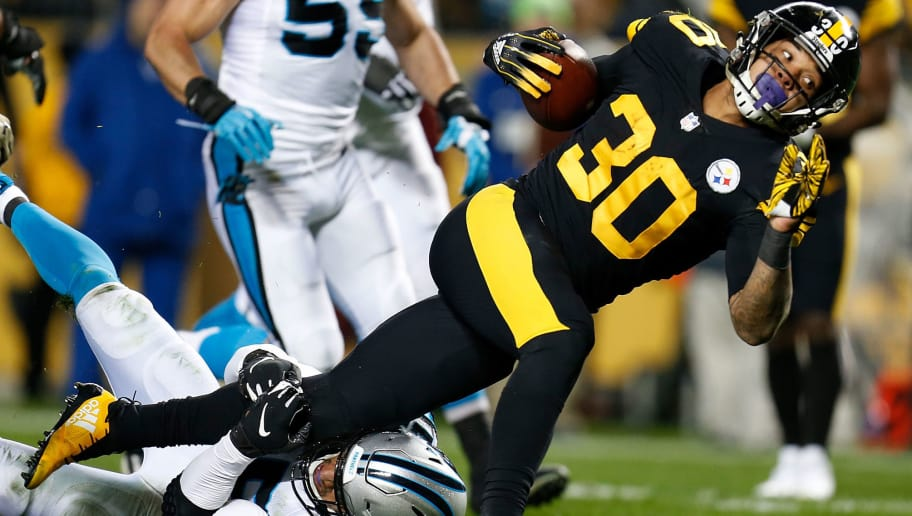 PITTSBURGH, PA - NOVEMBER 08: James Conner #30 of the Pittsburgh Steelers carries the ball against Eric Reid #25 of the Carolina Panthers during the first half in the game at Heinz Field on November 8, 2018 in Pittsburgh, Pennsylvania. (Photo by Justin K. Aller/Getty Images)