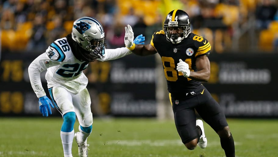 PITTSBURGH, PA - NOVEMBER 08: Antonio Brown #84 of the Pittsburgh Steelers runs a route as Donte Jackson #26 of the Carolina Panthers defends during the first half in the game at Heinz Field on November 8, 2018 in Pittsburgh, Pennsylvania. (Photo by Justin K. Aller/Getty Images)