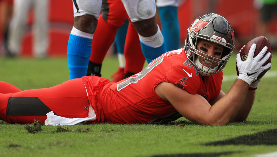 TAMPA, FLORIDA - DECEMBER 02: Cameron Brate #84 of the Tampa Bay Buccaneers scores a touchdown in the first quarter against the Carolina Panthers at Raymond James Stadium on December 02, 2018 in Tampa, Florida. (Photo by Mike Ehrmann/Getty Images)