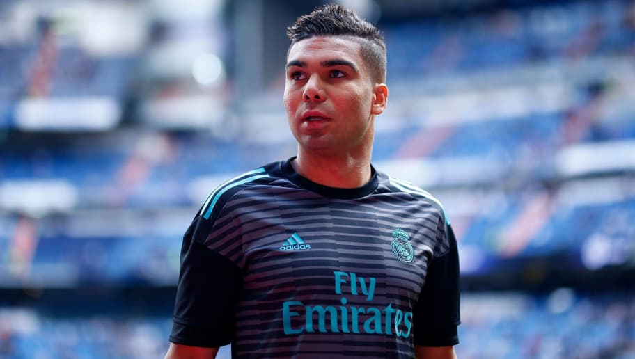 Real Madrid's Brazilian midfielder Casemiro warms up before the Spanish league football match between Real Madrid and Celta Vigo at the Santiago Bernabeu Stadium in Madrid on May 12, 2018. (Photo by Benjamin CREMEL / AFP)        (Photo credit should read BENJAMIN CREMEL/AFP/Getty Images)