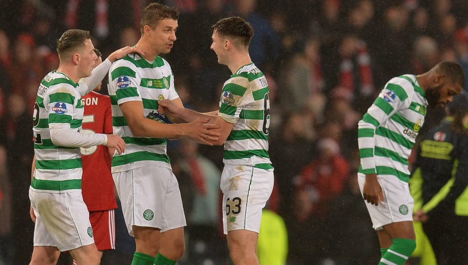 GLASGOW, SCOTLAND - DECEMBER 02: Callum McGregor, Jozo Simunovic and Keiran Tierney of Celtic celebrate at the final whistle as Celtic beat Aberdeen 1-0 during the Betfred Cup Final between Celtic and Aberdeen at Hampden Park on December 2, 2018 in Glasgow, Scotland. (Photo by Mark Runnacles/Getty Images)