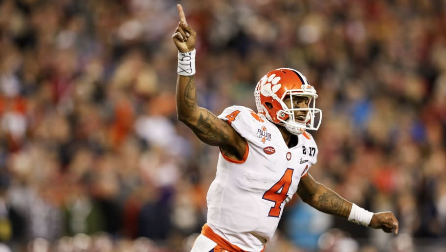 TAMPA, FL - JANUARY 09: Quarterback Deshaun Watson #4 of the Clemson Tigers celebrates after a touchdown during the 2017 College Football Playoff National Championship Game against the Alabama Crimson Tide at Raymond James Stadium on January 9, 2017 in Tampa, Florida. The Clemson Tigers defeated The Alabama Crimson Tide 35 to 31. (Photo by Don Juan Moore/Getty Images)