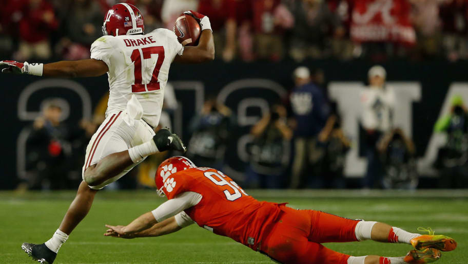 GLENDALE, AZ - JANUARY 11:  Kenyan Drake #17 of the Alabama Crimson Tide returns a kickoff for a 95 yards touchdown in the fourth quarter against the Clemson Tigers during the 2016 College Football Playoff National Championship Game at University of Phoenix Stadium on January 11, 2016 in Glendale, Arizona.  (Photo by Kevin C. Cox/Getty Images)