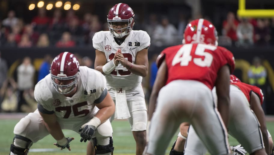 ATLANTA, GA - JANUARY 08: Tua Tagovailoa #13 of the Alabama Crimson Tide commands the offense against the Georgia Bulldogs during the College Football Playoff National Championship held at Mercedes-Benz Stadium on January 8, 2018 in Atlanta, Georgia. Alabama defeated Georgia 26-23 for the national title. (Photo by Jamie Schwaberow/Getty Images)