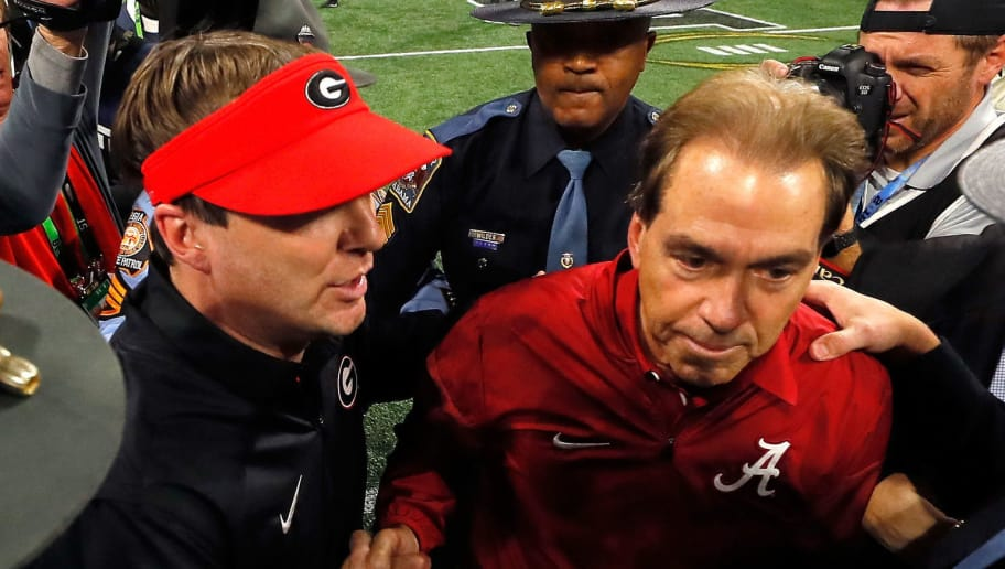 ATLANTA, GA - JANUARY 08: Head coach Nick Saban of the Alabama Crimson Tide shakes hands with head coach Kirby Smart of the Georgia Bulldogs after winning the CFP National Championship presented by AT&T in overtime at Mercedes-Benz Stadium on January 8, 2018 in Atlanta, Georgia.  (Photo by Kevin C. Cox/Getty Images)