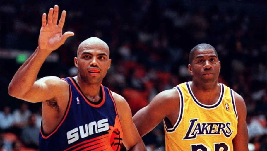 LOS ANGELES, UNITED STATES:  Charles Barkley of the Phoenix Suns waves to fans as Magic Johnson (R) of the Los Angeles Lakers watches during their 14 April game in Inglewood, California. Barkley, who with Johnson won the gold medal during the 1992 Summer Olympics, was chosen to play for the United States in the 1996 Summer Olympics.  The Lakers won 118-114. AFP PHOTO  Vince BUCCI (Photo credit should read Vince Bucci/AFP/Getty Images)