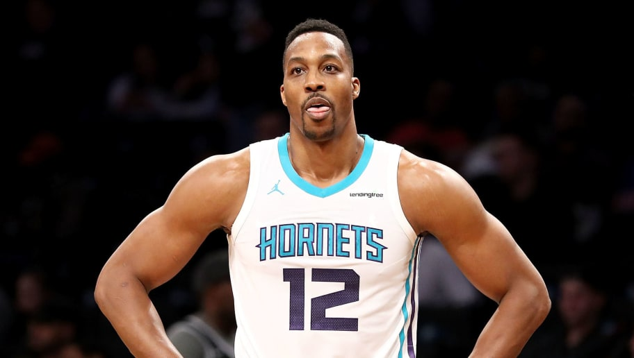 NEW YORK, NY - MARCH 21:  Dwight Howard #12 of the Charlotte Hornets reacts in the third quarter against the Brooklyn Nets during their game at Barclays Center on March 21, 2018 in the Brooklyn borough of New York City. NOTE TO USER: User expressly acknowledges and agrees that, by downloading and or using this photograph, User is consenting to the terms and conditions of the Getty Images License Agreement.  (Photo by Abbie Parr/Getty Images)