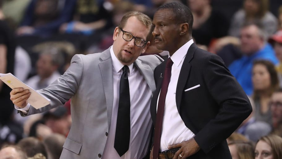 TORONTO, ON - FEBRUARY 15: Head coach Dwane Casey of the Toronto Raptors listens to assistant coach Nick Nurse against the Charlotte Hornets during NBA game action at Air Canada Centre on February 15, 2017 in Toronto, Canada. NOTE TO USER: User expressly acknowledges and agrees that, by downloading and or using this photograph, User is consenting to the terms and conditions of the Getty Images License Agreement. (Photo by Tom Szczerbowski/Getty Images)