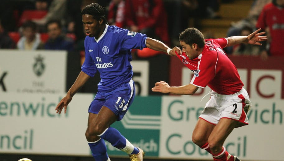 LONDON, ENGLAND - NOVEMBER 27:  Didier Drogba of Chelsea holds off Luke Young of Charlton Athletic during the Barclays Premiership match between Charlton Athletic and Chelsea, held at The Valley Stadium on November 27, 2004 in London, England.  (Photo by Richard Heathcote/Getty Images)