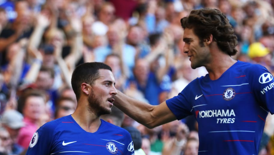 LONDON, ENGLAND - SEPTEMBER 01:  Eden Hazard of Chelsea celebrates with teammate Marcos Alonso after scoring his team's second goal during the Premier League match between Chelsea FC and AFC Bournemouth at Stamford Bridge on September 1, 2018 in London, United Kingdom.  (Photo by Clive Rose/Getty Images)