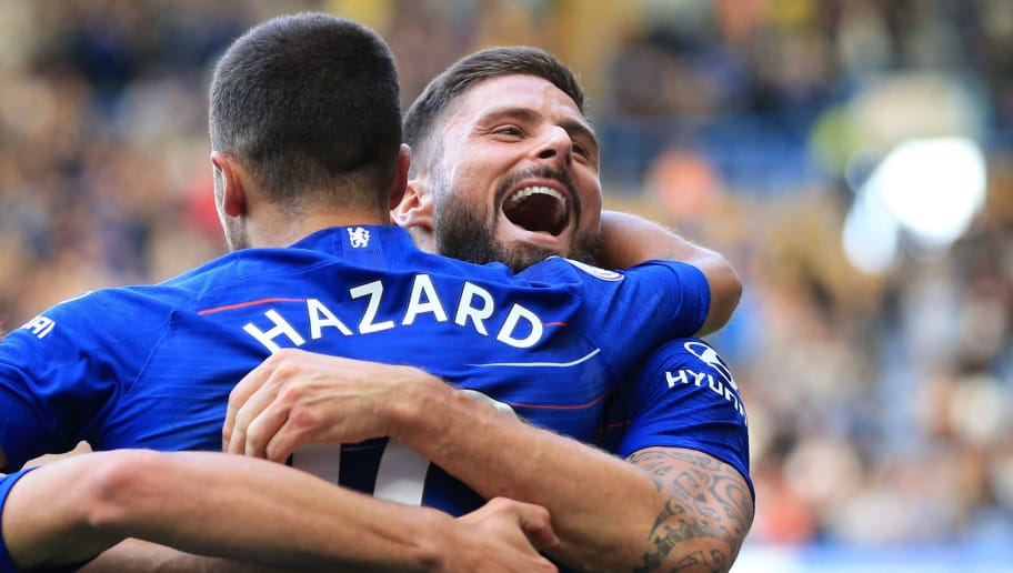 LONDON, ENGLAND - SEPTEMBER 15: Olivier Giroud celebrates with Eden Hazard of Chelsea during the Premier League match between Chelsea FC and Cardiff City at Stamford Bridge on September 15, 2018 in London, United Kingdom. (Photo by Marc Atkins/Getty Images)