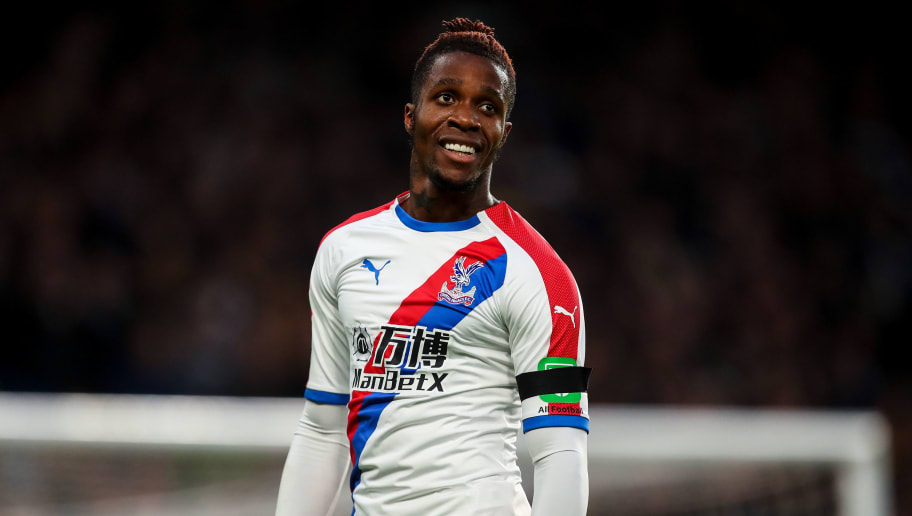 LONDON, ENGLAND - NOVEMBER 04: Wilfried Zaha of Crystal Palace reacts during the Premier League match between Chelsea FC and Crystal Palace at Stamford Bridge on November 4, 2018 in London, United Kingdom. (Photo by Robbie Jay Barratt - AMA/Getty Images)