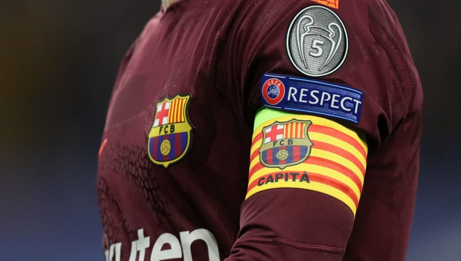 LONDON, ENGLAND - FEBRUARY 20: The UEFA Champions League badge, respect logo and captains arm band with a Catalan flag on Andres Iniesta of FC Barcelona during the UEFA Champions League Round of 16 First Leg  match between Chelsea FC and FC Barcelona at Stamford Bridge on February 20, 2018 in London, United Kingdom. (Photo by Matthew Ashton - AMA/Getty Images)