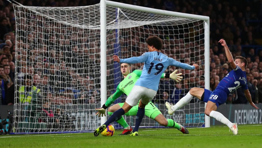 LONDON, ENGLAND - DECEMBER 08:  Kepa Arrizabalaga of Chelsea saves a shot from Leroy Sane of Manchester City during the Premier League match between Chelsea FC and Manchester City at Stamford Bridge on December 8, 2018 in London, United Kingdom.  (Photo by Clive Rose/Getty Images)