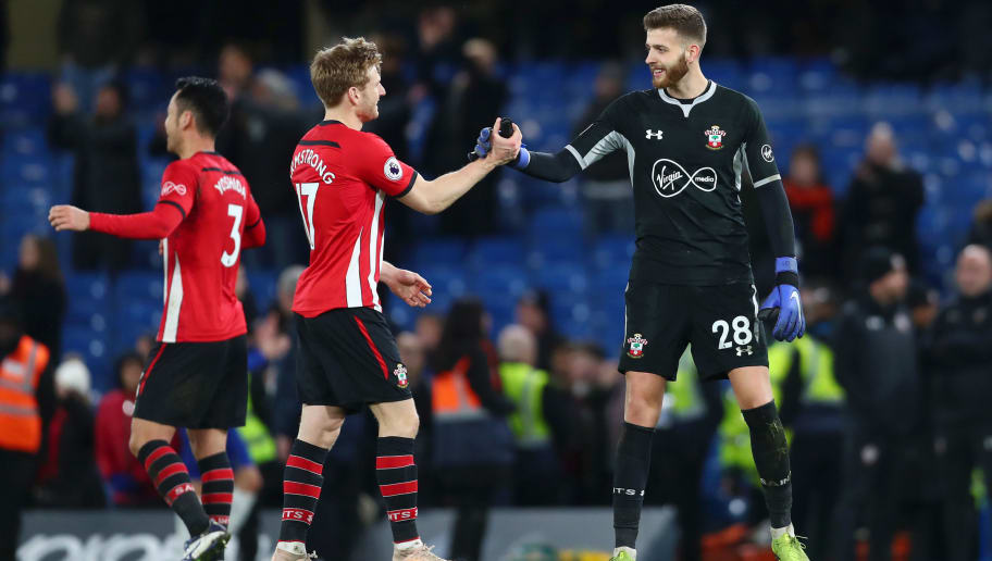 LONDON, ENGLAND - JANUARY 02:  Stuart Armstrong of Southampton shakes hands with Angus Gunn of Southampton after the Premier League match between Chelsea FC and Southampton FC at Stamford Bridge on January 2, 2019 in London, United Kingdom.  (Photo by Clive Rose/Getty Images)