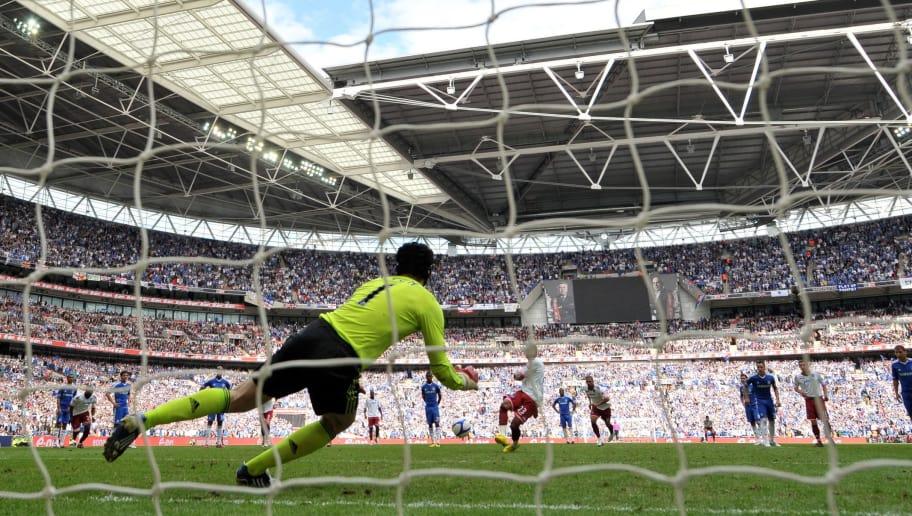 Chelsea goalkeeper Petr Cech (L) saves a