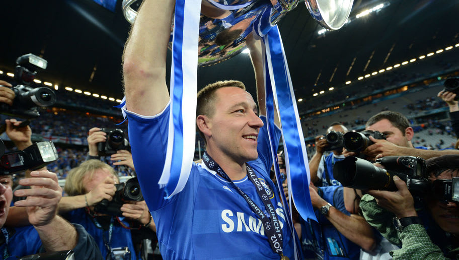 Chelsea's British defender John Terry  holds the trophy after the UEFA Champions League final football match between FC Bayern Muenchen and Chelsea FC on May 19, 2012 at the Fussball Arena stadium in Munich.  Chelsea won 4-3 in the penalty phase.  AFP PHOTO / ADRIAN DENNIS        (Photo credit should read ADRIAN DENNIS/AFP/GettyImages)