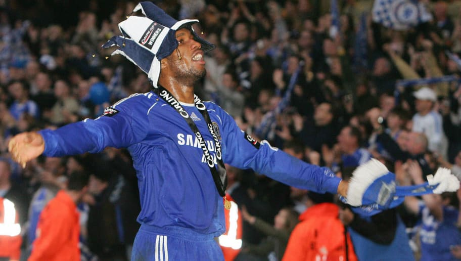 Cardiff, UNITED KINGDOM: Chelsea's Didier Drogba celebrates after beating Arsenal 2-1 in the English League Cup Final football match against Arsenal at The Millennium Stadium, Cardiff, Wales, 25 February 2007. AFP PHOTO / PAUL ELLIS Mobile and website use of domestic English football pictures subject to a subscription of a license with Football Association Premier League (FAPL) tel: +44 207 2981656. For newspapers where the football content of the printed and electronic versions are identical, no license is necessary. (Photo credit should read PAUL ELLIS/AFP/Getty Images)