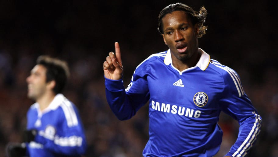 Chelsea's Didier Drogba of Ivory Coast (R) reacts after scoring against CFR Cluj during the Champions League Group A match at Stamford Bridge in London December 9, 2008. Drogba scored the winning goal with Chelsea winning the game 2-1. AFP PHOTO / Adrian Dennis (Photo credit should read ADRIAN DENNIS/AFP/Getty Images)