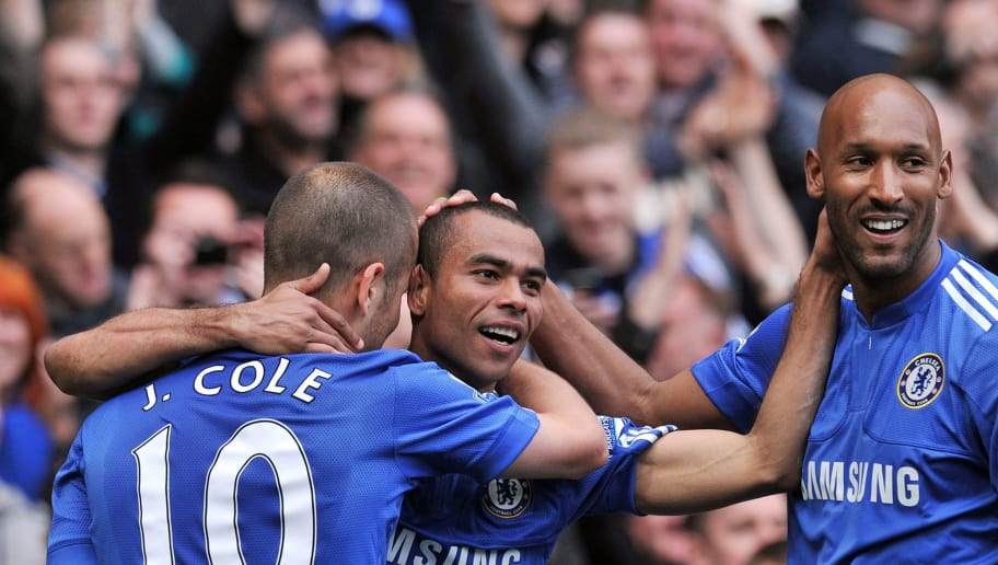 Chelsea's English defender Ashley Cole (2nd L) celebrates scoring their eighth goal with Team-mates English midfielder Joe Cole (L) and French striker Nicolas Anelka (R) of the English Premier League football match between Chelsea and Wigan Athletic at Stamford Bridge in London, England on May 9, 2010. AFP PHOTO/CARL DE SOUZA  FOR EDITORIAL USE ONLY Additional licence required for any commercial/promotional use or use on TV or internet (except identical online version of newspaper) of Premier League/Football League photos. Tel DataCo +44 207 2981656. Do not alter/modify photo. (Photo credit should read CARL DE SOUZA/AFP/Getty Images)