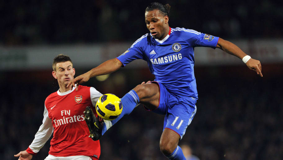 Chelsea's Ivory Coast striker Didier Drogba (R) vies with Arsenal's French defender Laurent Koscielny (L) during their English Premier League football match against Arsenal at the Emirates Stadium, London, on December 27, 2010. AFP PHOTO/CARL DE SOUZAFOR EDITORIAL USE ONLY Additional licence required for any commercial/promotional use or use on TV or internet (except identical online version of newspaper) of Premier League/Football League photos. Tel DataCo +44 207 2981656. Do not alter/modify photo. (Photo credit should read CARL DE SOUZA/AFP/Getty Images)