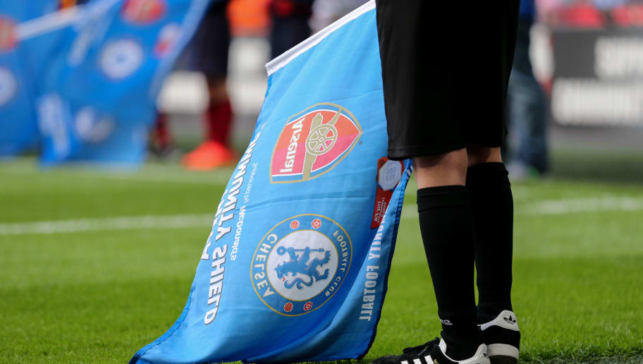 LONDON, ENGLAND - AUGUST 06: A mascot holds a Community Shield flag prior to the The FA Community Shield between Chelsea and Arsenal at Wembley Stadium on August 6, 2017 in London, England.  (Photo by Robbie Jay Barratt - AMA/Getty Images)