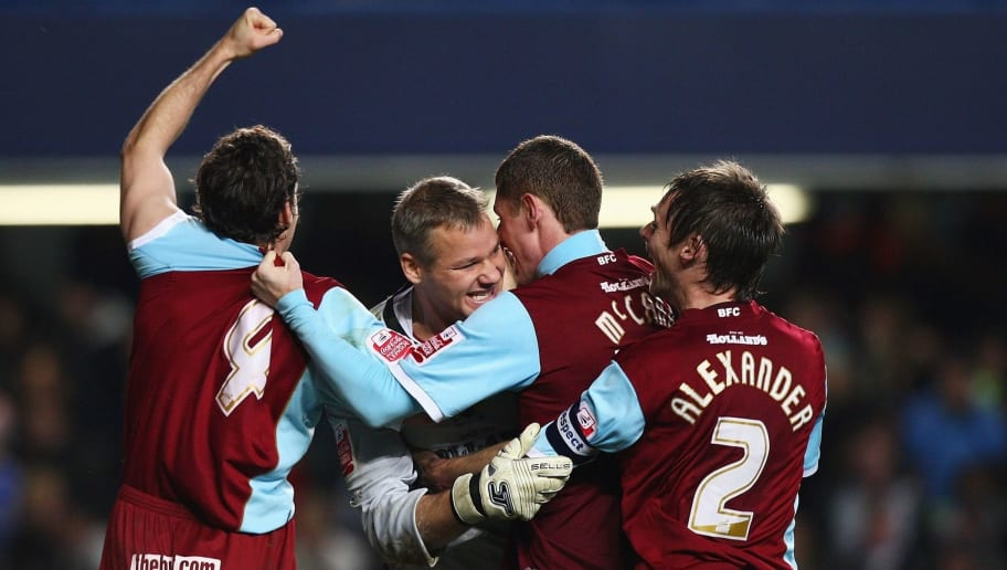 LONDON - NOVEMBER 12:  Goalkeeper Brian Jensen (2nd L) of Burnley is congratulated by team mates after the penalty shoot-out in the Carling Cup Fourth Round match between Chelsea and Burnley at Stamford Bridge on November 12, 2008 in London, England.  (Photo by Ryan Pierse/Getty Images)