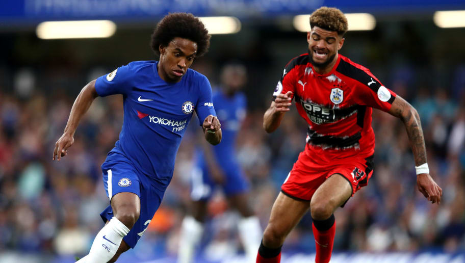 LONDON, ENGLAND - MAY 09: Willian of Chelsea is challenged by Philip Billing of Huddersfield Town during the Premier League match between Chelsea and Huddersfield Town at Stamford Bridge on May 9, 2018 in London, England.  (Photo by Clive Mason/Getty Images)