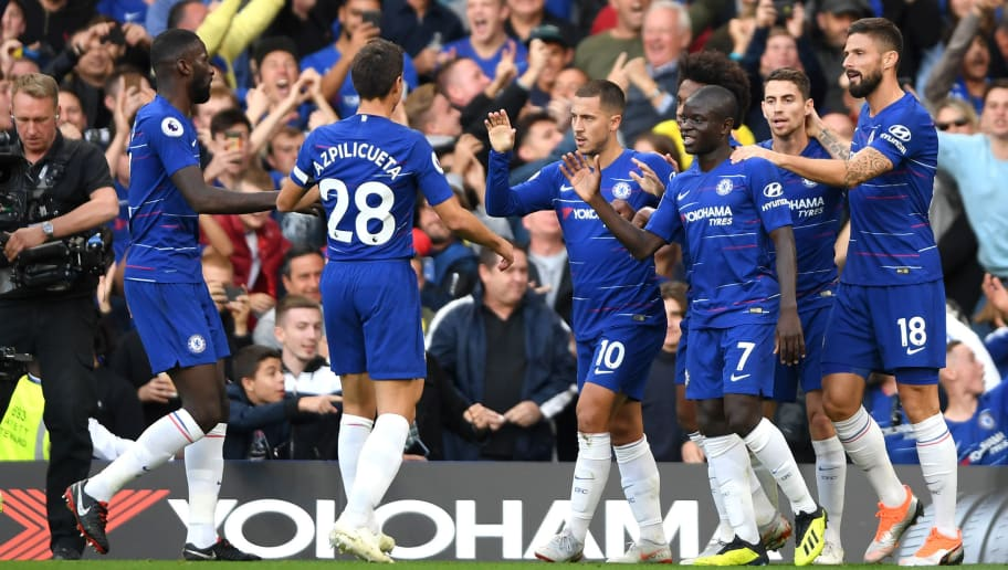 LONDON, ENGLAND - SEPTEMBER 29:  Eden Hazard of Chelsea celebrates with teammates after scoring the opening goal during the Premier League match between Chelsea FC and Liverpool FC at Stamford Bridge on September 29, 2018 in London, United Kingdom.  (Photo by Mike Hewitt/Getty Images)