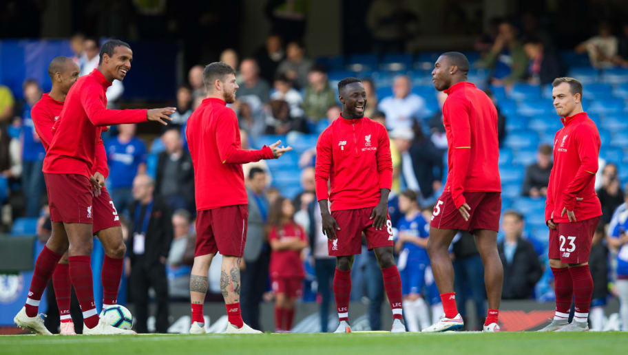 LONDON, ENGLAND - SEPTEMBER 29:  Naby Keita of Liverpool shares a joke with teammates during the pre-match warm-up during the Premier League match between Chelsea FC and Liverpool FC at Stamford Bridge on September 29, 2018 in London, United Kingdom. (Photo by Craig Mercer/MB Media/Getty Images)