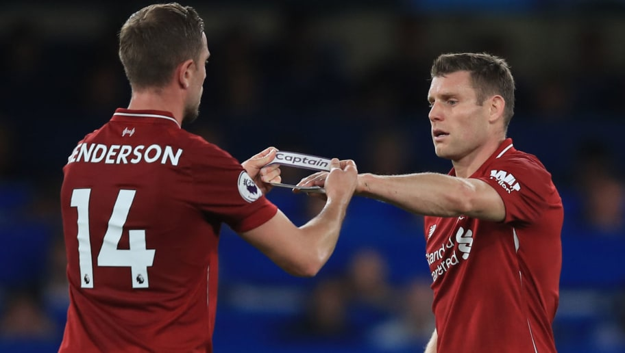 LONDON, ENGLAND - SEPTEMBER 29: Jordan Henderson of Liverpool passes the Captains armband to James Milner as he is substituted during the Premier League match between Chelsea FC and Liverpool FC at Stamford Bridge on September 29, 2018 in London, United Kingdom. (Photo by Marc Atkins/Getty Images)