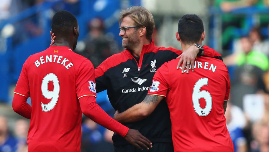 LONDON, ENGLAND - OCTOBER 31:  Jurgen Klopp (C), manager of Liverpool celebrates his team's 3-1 win with his players Christian Benteke (L) and Dejan Lovren (R) after the Barclays Premier League match between Chelsea and Liverpool at Stamford Bridge on October 31, 2015 in London, England.  (Photo by Clive Rose/Getty Images)